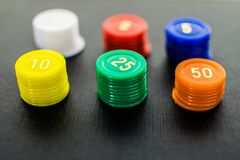 Close up of colored stacked casino chips royalty free stock photography