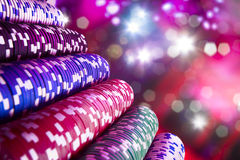 Casino chips with dramatic lighting and lens flares Royalty Free Stock Image