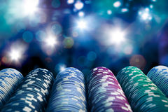 Casino chips with dramatic lighting and lens flares Stock Photos