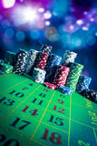 Casino chips with dramatic lighting and lens flares Stock Images