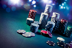 Casino chips with dramatic lighting and lens flares Stock Image