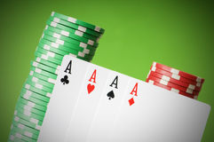 Casino chips and four aces Royalty Free Stock Image