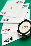 Casino chips and four aces Stock Image