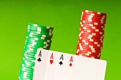 Casino chips and four aces Royalty Free Stock Photos