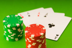 Casino chips and four aces Royalty Free Stock Photo