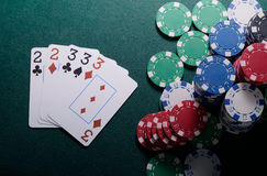 Casino chips and full house cards combination on the green table. Poker game concept Royalty Free Stock Photography