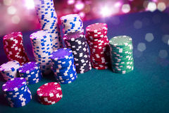 Casino chips on gaming table Royalty Free Stock Image