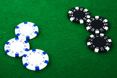 Casino chips on green Royalty Free Stock Image