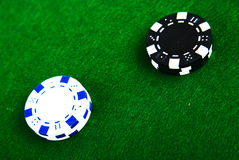 Casino chips on green Stock Images