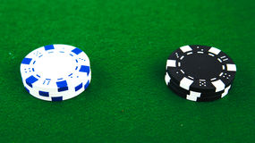 Casino chips on green Royalty Free Stock Photos