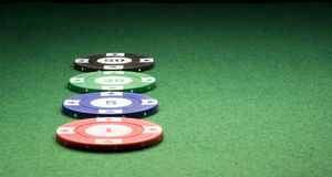 Casino Chips on Green Royalty Free Stock Images