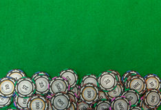 Casino chips on green background image Stock Photography