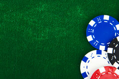 Casino chips on green felt Royalty Free Stock Image