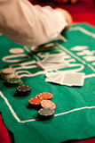 Casino chips on green felt background. Card player gambling casino chips on green felt background selective focus Stock Images