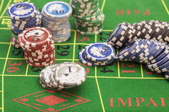 Casino chips on green felt game table Stock Image
