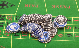 Casino chips on green felt game table Royalty Free Stock Photo