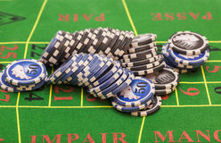 Casino chips on green felt game table Royalty Free Stock Photography