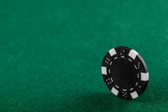 Casino chips. On the green table stock photo