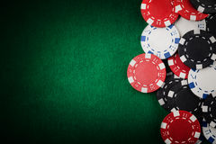Casino chips. On the green table Royalty Free Stock Photos