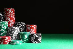 Casino chips on green table royalty free stock images