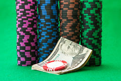 Casino chips on green table with Dollar Royalty Free Stock Image