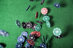 Casino chips on a green table Royalty Free Stock Images