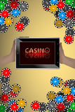 Casino chips and hands with tablet computer Royalty Free Stock Photos