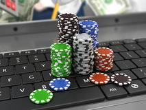 Casino chips on the keyboard. Online games concept Stock Images