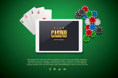 Casino chips and mobile  on green background Stock Photo
