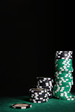 Casino chips over black Royalty Free Stock Images