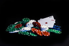 Casino chips, playing cards isolated. On black background Stock Image