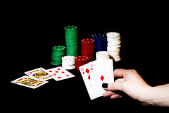 Casino chips, playing cards isolated. On black background Stock Images
