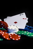 Casino chips, playing cards isolated. On black background Royalty Free Stock Photo