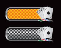 Casino chips and playinging cards on checkered tab Royalty Free Stock Photo