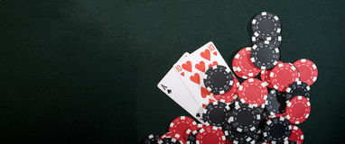 Casino chips and poker cards. Casino chips on a green background and texas holdem poker cards. Vegas concept stock images