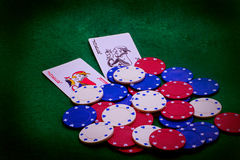 Casino chips and poker cards. Image of casino chips on a green background and poker cards Royalty Free Stock Image