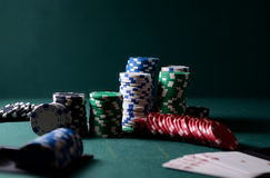 Casino chips and royal flush cards combination on the green table. Poker game theme Royalty Free Stock Photo