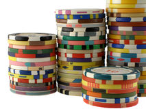 Casino chips stacks. Four stacks of multicoloured casino chips royalty free stock photos