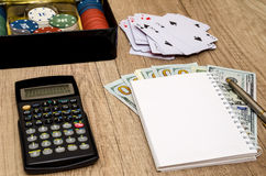 Casino chips in suitcase with us money, cards, notepad Royalty Free Stock Images