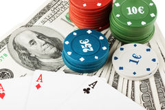 Casino colorful chips and dollars Royalty Free Stock Photos