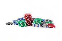 Casino colorful chips isolated on white Royalty Free Stock Photo