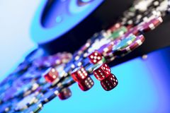 Casino concept. Place for text. High contrast image of casino roulette, poker chips, cards, dice. Place for text or typography royalty free stock photo