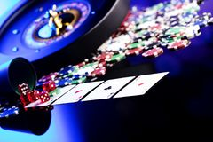 Casino concept. Place for text. High contrast image of casino roulette, poker chips, cards, dice. Place for text or typography stock images