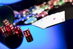 Casino concept. Place for text. High contrast image of casino roulette, poker chips, cards, dice. Place for text or typography stock photos