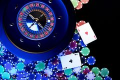 Casino concept. Place for text. High contrast image of casino roulette, poker chips, cards, dice. Place for text or typography stock photo