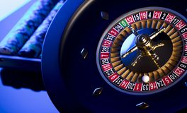 Casino concept. Place for text. High contrast image of casino roulette, poker chips, dice. Place for text or typography stock photos