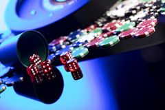 Casino concept. Place for text. High contrast image of casino roulette, poker chips, dice. Place for text or typography royalty free stock images