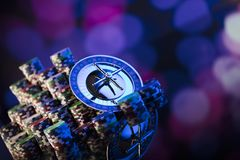 Casino concept. Place for typography. High contrast image of casino roulette, poker chips. Blue light and place for text royalty free stock photo