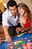Casino couple Stock Image