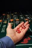 Casino craps. Image of craps game in progress. The dice are about to be released from the players hand down the craps table Royalty Free Stock Photos